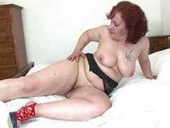 a woman aged masturbates unbridled hole