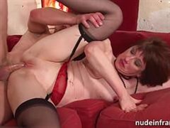 an experienced woman in stockings shag with a young